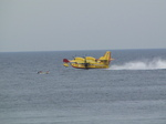 SX19793 Fire airplane taking in water.jpg