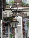 SX19825 Lantern with flowers on balcony in background, Troyes, France.jpg
