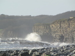 SX21204 Waves crashing at cliffs by Llantwit Major beach.jpg