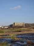 SX21461 Manorbier castle from stream into Manorbier bay.jpg