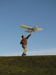 SX22360 Richard with RC plane lifting off.jpg