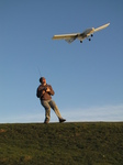 SX22361 Richard with RC plane lifting off.jpg