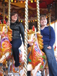 SX22575 Jenni and Libby on carousel in Cardiff Bay.jpg