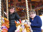 SX22581 Jenni and Libby on carousel in Cardiff Bay.jpg