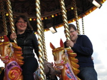 SX22582 Jenni and Libby on carousel in Cardiff Bay.jpg
