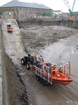SX26448 Big and small lifeboat tracktors going up slipway.jpg