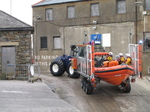 SX26452 Big lifeboat tracktor going up slipway.jpg