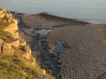 SX32363 Shadows of sunset on rocks at Llantwit Beach.jpg