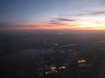 SX32593 Sunset from airplane with lit up greenhouses.jpg
