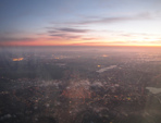 SX32598-9 Sunset from airplane over city lights.jpg