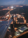 SX32638 Airplane wing over city lights.jpg