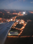 SX32639 Airplane wing over town lights.jpg