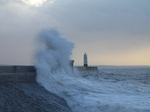 SX33381 Waves at Porthcawl lighthouse.jpg