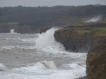 LZ00560 Waves crashing against cliffs at Llantwit Major beach.jpg