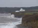 LZ00580 Waves crashing against cliffs at Llantwit Major beach.jpg