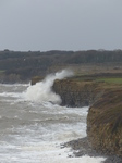 LZ00667 Waves crashing against cliffs at Llantwit Major beach.jpg