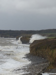 LZ00676 Waves crashing against cliffs at Llantwit Major beach.jpg