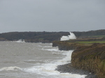 LZ00715 Waves crashing against cliffs at Llantwit Major beach.jpg