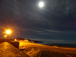 FZ010568 Moon as bright as streetlamp at Exmouth beach.jpg