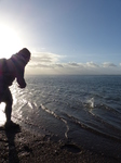 FZ010582 Jenni skipping stones from Exmouth beach.jpg