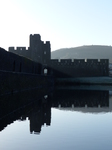 FZ010762 Sun rays over Caerphilly castle wall.jpg