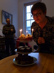 FZ011755 Jenni blowing out candles on birthday cakes.jpg