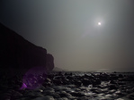 FZ012299-300 Partial solar eclips at Llantwit Major beach.jpg
