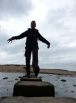 FZ012510 Wouko on stepping stones at Three Cliffs Bay.jpg