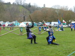 FZ013180 Black and blue knights fighting below Glastonbury Tor.jpg