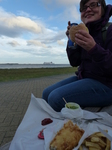 FZ019396 Jenni eating fish and chips with ferry coming in.jpg