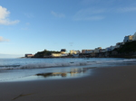FZ020895 Reflection in beach of colourful houses in Tenby.jpg