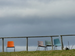 FZ023693 Chairs with dark clouds.jpg