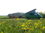 FZ029127 Campervan on campsite with flowers.jpg